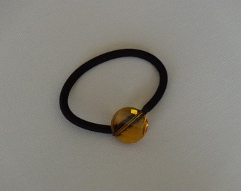 Golden yellow faceted round glass bead, ponytail holder