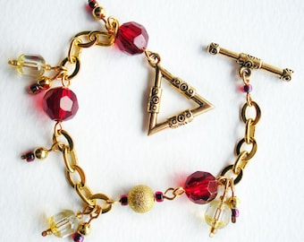 Charm Bracelet Handmade with Red Glass Beads and Gold Chain