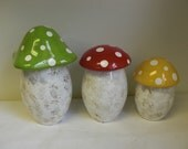 Set of Three Bright Colorful Mushroom Canisters in Bright Green, Red, and Yellow