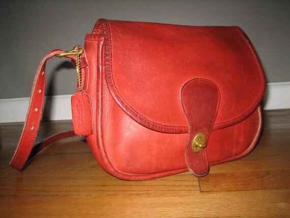 a red leather satchel handbag