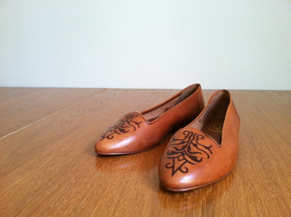 1980's brown leather flats hand tooled design.  size 8B