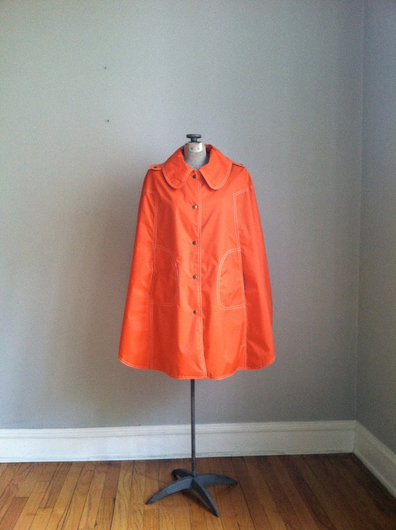 1970's brilliant orange rain cape. poncho.
