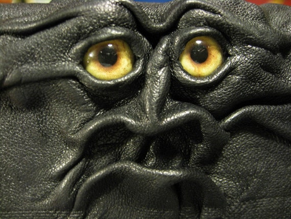 Grichels leather cell phone case - black with honey brown coyote eyes