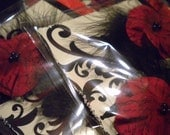 Two Red and Black Vintage Style Flowers