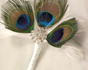 Peacock feather pin on corsage