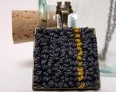 Gray ocher fiber pendant necklace with antique bronze square back
