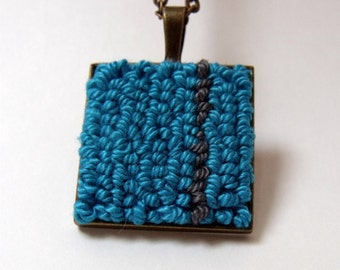 Turquoise gray fiber pendant necklace with antique bronze square back