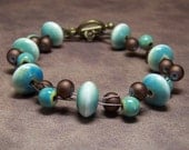Kate Bracelet with Soft Green and Brown Ceramic and Glass Beads
