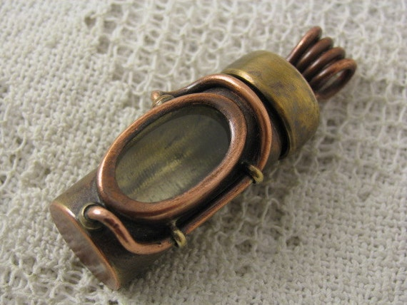 Waterproof pill bottle pendant. relic holder. Screw on cap. Brass, copper and glass. Reliquary