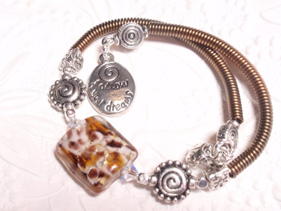 Amber, Black and White Memory Wire Bracelet with Charms