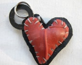 black and red patchwork heart charm