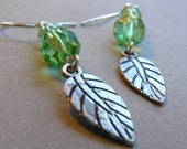 RESERVED FOR HOTJAVVA Peridot Feather Earrings