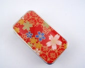 Pretty pop of color with colorful flowers - Stash your secrets in this cool small slider tin - Resin protected Chiyogami top