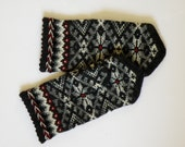 High quality hand knitted warm wool mittens , gloves patterned dark black with red eyes