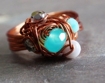 Aqua ring: copper wire translucent turquoise faceted glass white cat's eye glass faceted teal glass fire polished clear gray faceted glass