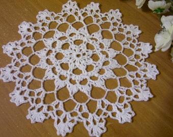 white crocheted doily