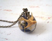 Global Traveler. Flying Bird with Globe Necklace