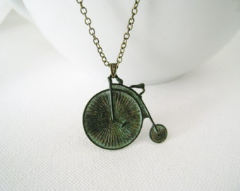 Bicycle Necklace. old fashion penny farthing verdigris patina bicycle in antique brass chain