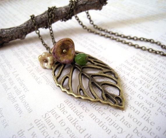 Filigree Leaf Necklace. antique brass leaf pendant with flowers