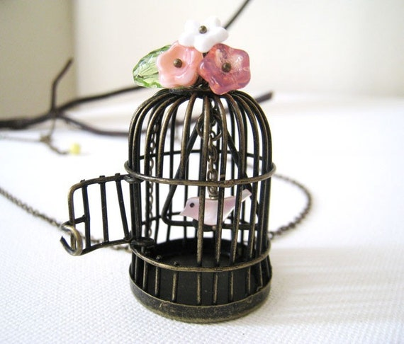 Birdcage Necklace. whimsical bird cage in antique bronze with pink flowers and sea shell bird