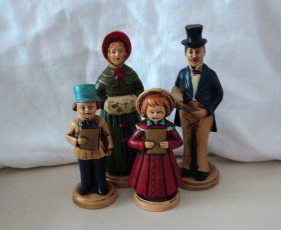 vintage four christmas caroler figures made in japan