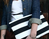 Oversized Black and white striped zippered clutch.
