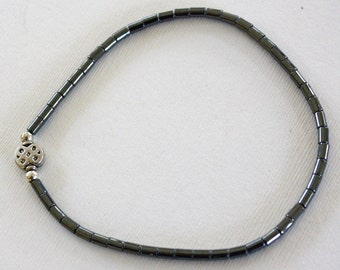 Hematite anklet with silver focal on stretch magic 10 inches long