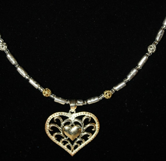 10K gold and sterling Heart necklace approx 18 inches long