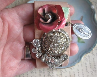 Sacred Heart .leather cuff  vintage rhinestones and jewelry assemblage bracelet