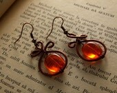copper wired earrings with orange glass bead