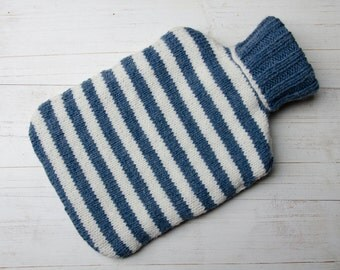 Hand knitted hot water bottle cover in denim blue and cream stripes