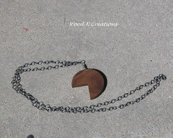 Walnut Wood Pendant Necklace with a Bite Missing