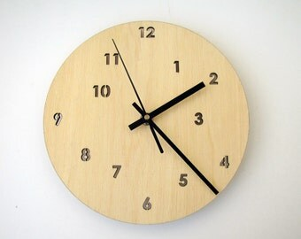 Wood wall clock. Constellation of numbers.