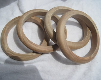 Four Small Slender Unfinished Wood Bangles