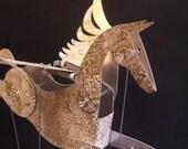 Large Aluminium Pegasus Automata stamped in gold.