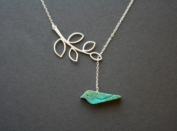 Blue bird on white gold leaf necklace