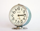 Vintage Russian mechanical alarm clock Slava from Soviet Union period turquoise green clock