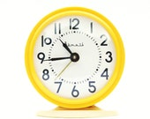 Vintage Russian mechanical alarm clock Vitjaz from Soviet Union period yellow color