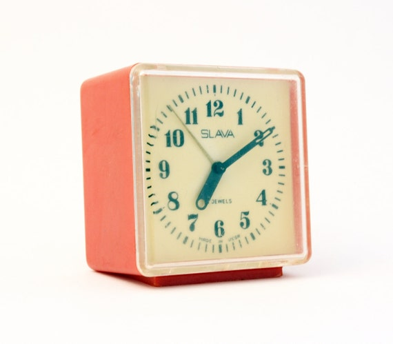 Vintage Russian mechanical alarm clock Slava from Soviet Union period  red alarm clock