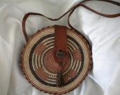 basket weave purse with leather trim