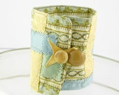arm cuff coffee cuff bookmark in blue, aqua and gold repurposed fabrics ooak tagt team