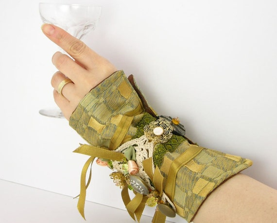 arm cuff  in gold and olive repurposed brocade crochet ribbon buttons roses victorian romantic steampunk ooak teamt tagt team