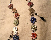 Colorful rhinestone necklace with black cut glass pendants and watch parts