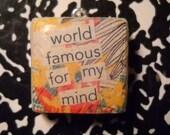 "scrabble tile pendant ""world famous for my mind"""