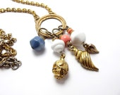 Long Gold tone Nautical Necklace, milk glass beads, shell pendants, late 80s