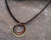 handmade forged mix metals circles hung on leather necklace