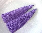 Two moroccan light purple art silk tassels