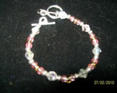 pink, gold, and clear glass beaded bracelet