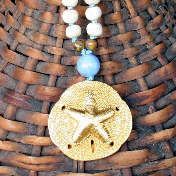 gold sand dollar with aquamarine and bone...