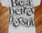 human rights equality Be A Better Person black and white hand stenciled tshirt by Rainbow Alternative on Etsy